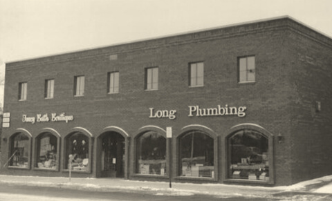 Historic photo of Long Bath Boutique and Long Plumbing building exterior